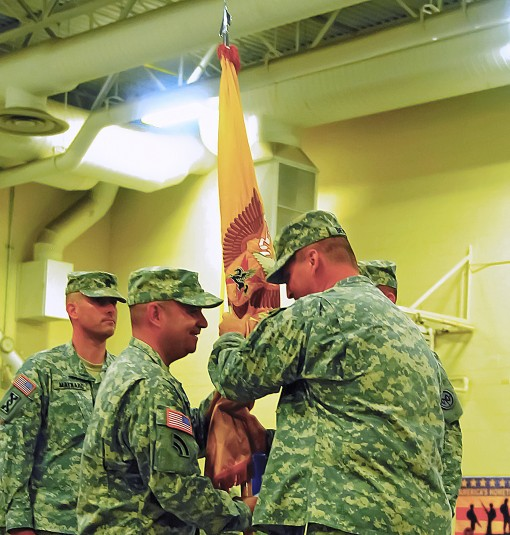 Col. Joesph Biehler, the 27th IBCT commander, presents the 427th Brigade Support Battalion's colors to Lt. Col. Patrick Clare during a battalion change of command ceremony in Syracuse Sept. 12. Clare, who previously served as the 427th executive offi