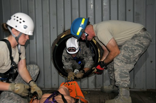 --New York Air National Guard Staff Sgt. Jennifer Bristol and Staff Sgt. Christopher Meyer (center) rescue a victim as Tech. Sgt. Brian Kissinger (right) assists during confined space training for the 109th Fire Departments search and rescue team at Strat