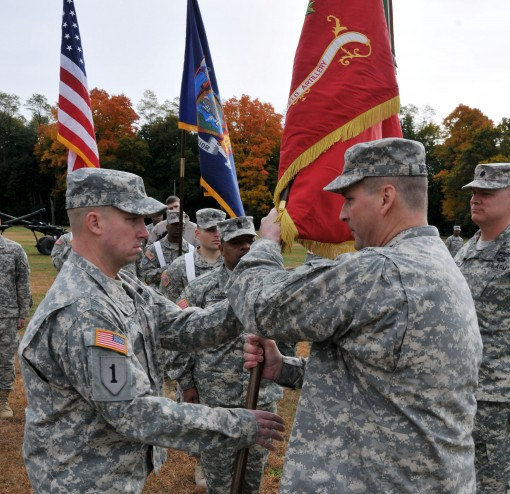 Lt. Col. Pete Mehling accepts the colors of the 1st Battalion 258th Field Artillery from Col. Joseph Biehler, the commander of the 27th Infantry Brigade Combat Team, during change-of-command ceremonies on Saturday Oct. 24, here.