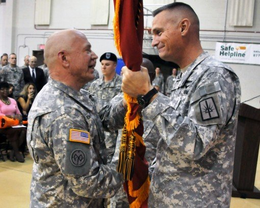 LATHAM --New York Army National Guard Command Sgt. Major David Piwowarski ( left) accepts the colors of the New York State Division of  Military and Naval Affairs from Major General Patrick Murphy the Adjutant General Of New York during a Change-of-Respon