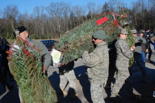New Yorkers Load Trees for Troops