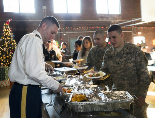 Soldiers of the 1156th Engineer Company are served Christmas Dinner by one of the company's officers during the unit's annual holiday gathering at the Armory here. Soldiers and their family members enjoyed a traditional military holiday dinner,