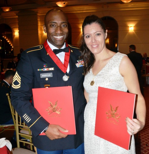 --New York Army National Guard Sgt 1st Class Jonathan Morrison a member of Headquarters Battery 1st Battalion 258th Field Artillery poses with his wife Danielle Morrison during the annual St. Barbaras Day Dinner held on Friday Dec. 4 2015. Morrison was aw