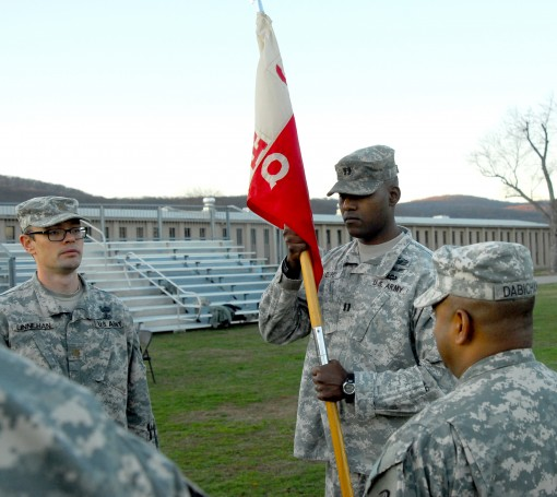 New York Army National Guard Capt. Odelle Despot accepts the guidon of Headquarters and Headquarters Company of the 369th Sustainment Brigade during change of command ceremonies conducted at Camp Smith Training Site on Saturday Dec. 5. He replaces Capt. L