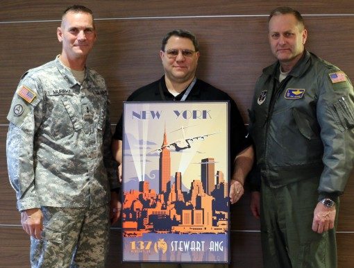Major General Patrick Murphy ( left) the Adjutant General of New York and Col. Timothy LaBarge the commander of the 105th Airlift Wing presented a 105th Airlift Wing poster to Oneida County Aviation Commissioner Russell Stark in recognition of the support