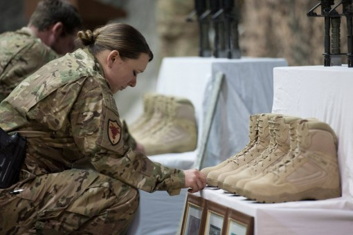 Soldiers and Airmen pay their respects to six Air Force members killed by a suicide bomber while on a mission outside Bagram Air Base on Monday, Dec. 21. Two of those killed -- Tech Sgt. Joseph Lemm and Staff Sgt.Michael Bonacasa-- were members of the New