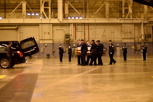 The remains of New York Air National Guard Tech. Sgt. Joseph G. Lemm are transferred from a C-17 to a hearse during a ceremony on Monday, Dec. 28, 2015 at Stewart Air National Guard Base by members of the 105th Airlift Wing.