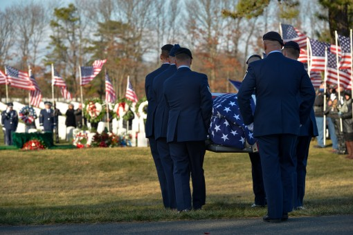 CALVERTON--Honor Guard members carry the coffin of New York Air National  Guard Staff Sgt. Louis Bonacasa to his final resting place at Calverton National Cemetery on Saturday, Jan. 2 during funeral services.