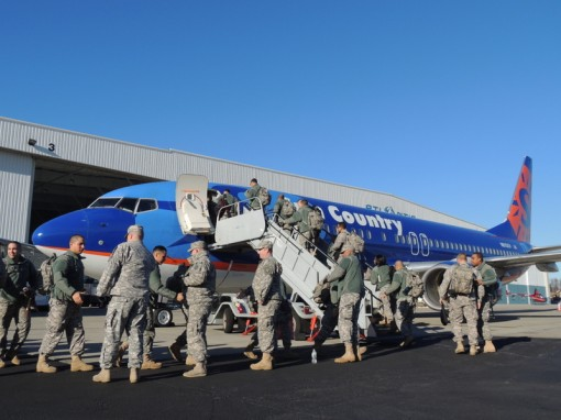 Soldiers of the New York Army National Guard's 442nd Military Police Company board an aircraft at Stewart International Airport on Tuesday, Jan. 5, en route to Fort Bliss, Texas.