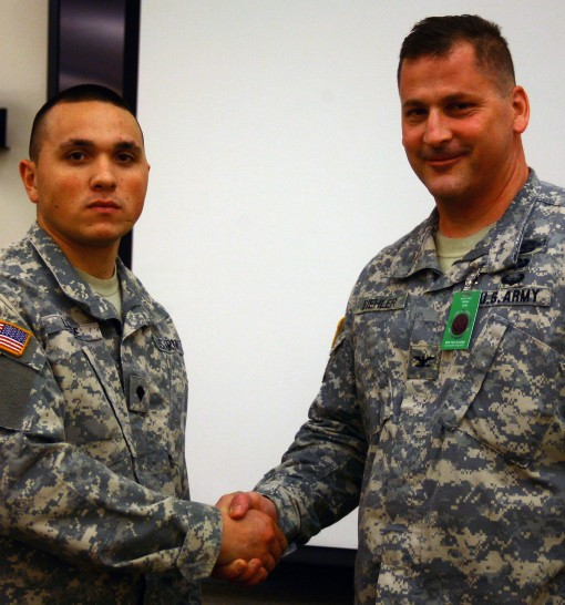 Col. Joseph Biehler( right) commander of the 27th Infantry Brigade Combat TEam , congratulates Specialist Dylan Lunde, from Patchogue, on being selected as the brigade's best enlisted Soldier for 2016. Lunde is a member of  Battery B 1st Battalion 25