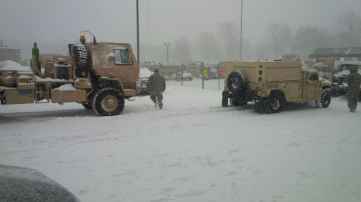Soldiers assigned to the New York Army National Guards 145th Maintenance Company ready their vehicles for deployment on at the Manor Road Armory on Staten Island on Saturday Jan. 23 2016 as a blizzard pummeled New York City. Eighty-nine of the units Soldi