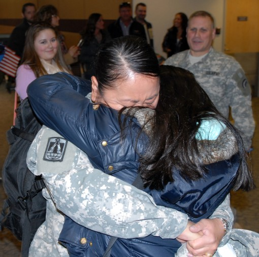 New York Army National Guard Sgt. 1st Class Theresa Barone-Lopez  embraces her daughter Juliana at the Albany International Airport here on Jan. 27 2016.