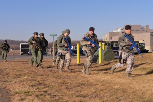 Members of the 105th Base Defense Squadron and the Orange County Sheriff's Office run to conduct secondary sweeps of a building and remove simulated casualties during an active shooter response exercise at Stewart Air National Guard Base on Feb. 7. T