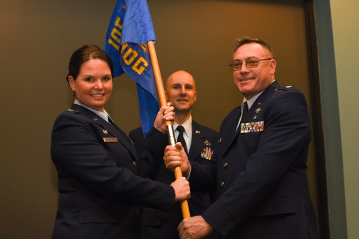--Lieutenant Col. Linda Rohatsch 105th Medical Group Commander passes the group guide-on to Major John Reynolds 105th CBRN Detachment Medical Commander at an Assumption of Command ceremony at Stewart Air National Guard Base Newburgh NY on February 7 2016.