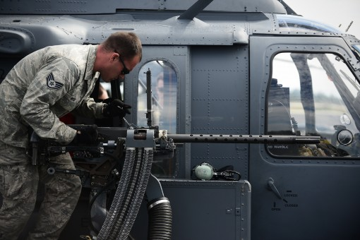 Staff Sgt. Barry Wood an airman with the 106th Rescue Wing checks a .50 caliber machine gun on an HH-60 Pavehawk helicopter prior to a training flight at Homestead Air Reserve Base Florida on January 19 2016.