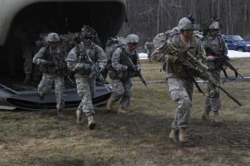 New York Army National Guard Soldiers of Troop C, 2nd Squadron, 101st Cavalry Regiment exit a CH-47 Chinook helicopter with the engines running during a training mission Saturday, Feb. 20, 2016 at the Youngstown Training Area here. The cavalry troopers te
