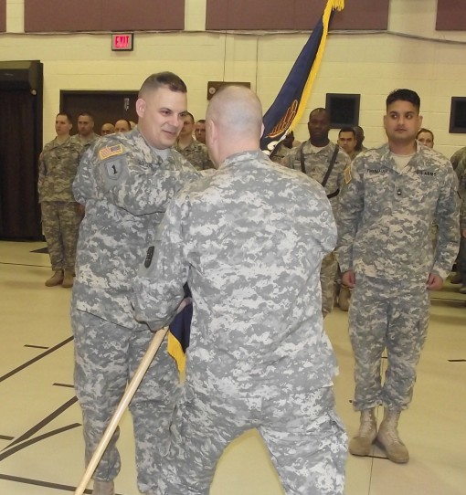 Lt. Col. Michael Tagliaferro accepts the colors of the 2nd Battalion 106th Regiment during change-of-command ceremonies on Saturday, March 5. Tagliaferro replaces  Lt. Col. Christopher Ciccone Jr. as the commander of the training unit.