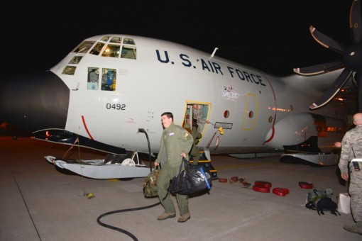 New York Air National Guard Maj. Timothy Novak, a navigator with the 109th Airlift Wing, exits an LC-130