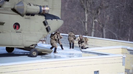 FORT DRUM - Members of the New York Air National Guard's 274th Air Support Operations Squadron (ASOS) disembark from a CH-47F helicopter flown by the New York Army National Guards Co. B 3rd Battalion 126th Aviation on to a rooftop LZ at Fort Drum N.Y
