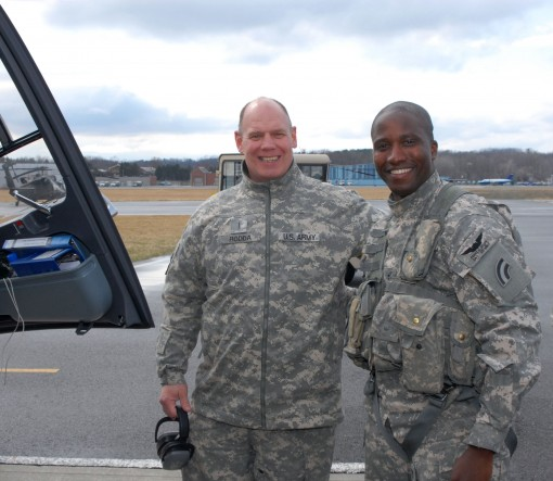 -New York Army National Guard Chief Warrant 2 Franz Scott (right), a member of Detachment 2, 1st battalion 224th Security and   Support  is greeted by Chief Warrant 5 Chuck Rodda after returning from a mission on the Mexican border on Friday, March 25, 20