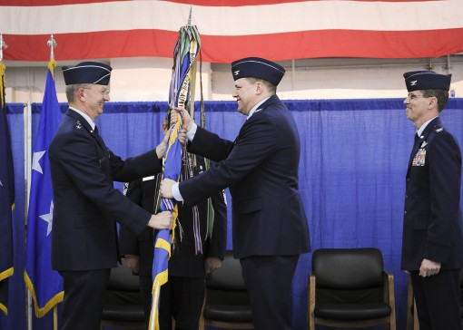 New York Air National Guard Col. Michael R. Smith the new commander of the  174th Attack Wing accepts the guidon from New York Air National Guard Maj. Gen. Anthony P. German the Commander of the New York Air National Guard during change of command ceremon
