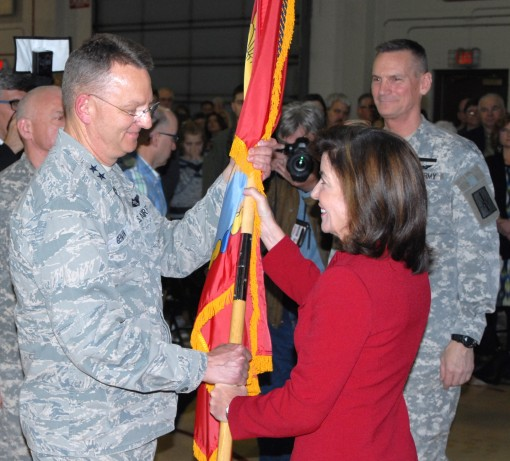 LATHAM, N.Y. -- New York State Lt. Gov. Kathleen C. Hochul (right) hands the New York State Division of Military and Naval Affairs (DMNA) colors to Maj. Gen. Anthony German (left), making him the 53rd adjutant general of the New York National Guard during
