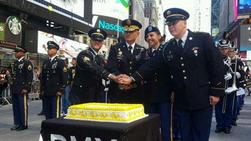 New York Army National Guard Sgt. Alexis Caceres ( far left) and Spc. Tanner Scheible ( far right) join Lt. Gen. Robert Caslan the Superintendent of the United States Military Academy; and Capt. Kelly Elminger an Army nurse and a member of the  American I