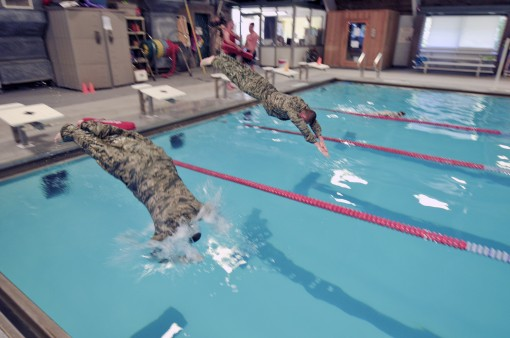 Airmen swim for a badge