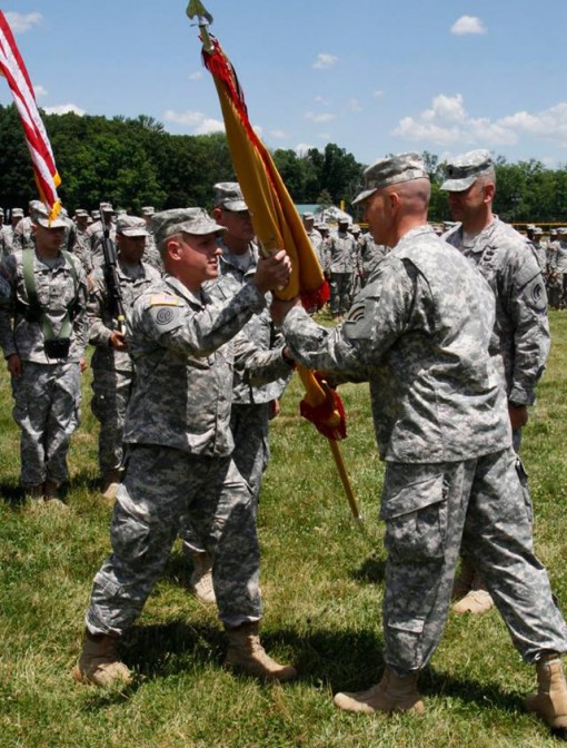 Lt.Col. Todd Bookless the new commander of the New York Army National Guards 642nd Aviation Support Battalion accepts the battalions colors from Col. Jack James (right) the commander of the 42nd Combat Aviation Brigade during change-of-command ceremonies