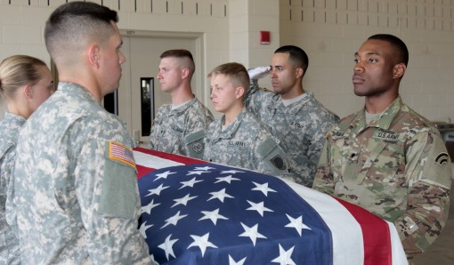 Three New York Army National Guard Soldiers along with five other National Guard Soldiers from across the country rehearse the specific movements and commands of a full military funeral during the 80-hour Train-the-trainer Military FuneralHonors course at