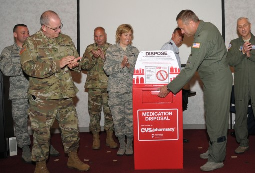 Brig.Gen. Timothy LaBarge Chief of Staff of the New York Air National Guard demonstrates the prescription drop box placed at Stratton Air National Guard Base by the  New York National Guard Counterdrug Task Force on Monday July 11 2016. The drop box locat