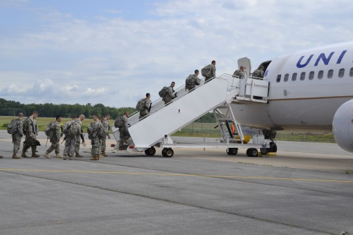 Soldiers assigned to the New York Army National Guards 27th Infantry Brigade Combat Team board a charter aircraft on Saturday July 9 2016 at Hancock Field Air National Guard Base in Syracuse N.Y. The Soldiers are heading to Fort Polk Louisiana for a three