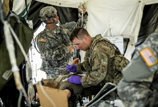 New York Army National Guard medics, assigned to Headquarters Co., 1st Battalion, 69th Infantry, triage a Soldier during a mass casualty exercise at the Armys Joint Readiness Training Center, Fort Polk, La., Saturday, July 16, 2016. More than 3,000 New Yo