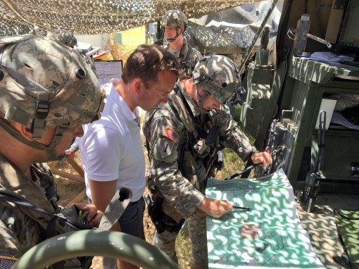 "New York Army National Guard Soldiers from the 1st Battalion, 258th Field Artillery provide Secretary of the Army Eric Fanning with a description of a ""call for fire"" July 20, 2016 at the Joint Readiness Training Center at Fort Polk, La. The bat"
