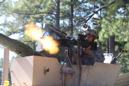 A cavalry scout from the New York Army National Guard's 2nd Squadron, 101st Cavalry provides supporting fires against an opposing force element during training at Fort Polk, La.