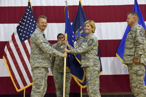 New York Air National Guard Command Chief Master Sgt. Amy Giaquinto accepts the colors of the New York Air National Guard from Major General Anthony German, commander of the New York Air National Guard and Adjutant General of New York, during Change of Au