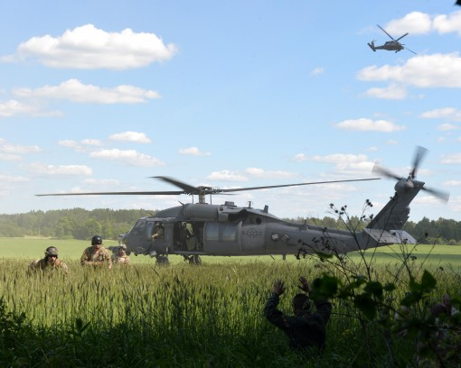 ararescue jumpers from the 103rd Rescue Squadron exit a U.S. Air Force HH-60 Pave Hawk helicopter and prepare to pick up two isolated personnel during Saber Strike 16 at Amari Air Base, Estonia June 14, 2016. Saber Strike is a multinational exercise that