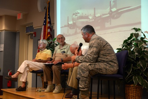 Three veterans of the 106th Rescue Wing-- Lt Col. Warren Ferdinansen ( white shirt) Chief MSgt. Edward Ogden ( tan shirt) and CMSgt. Richard Forrestal (yellow shirt) speak before members of the 106th Rescue Wing on August 7 2016.The three speakers are the