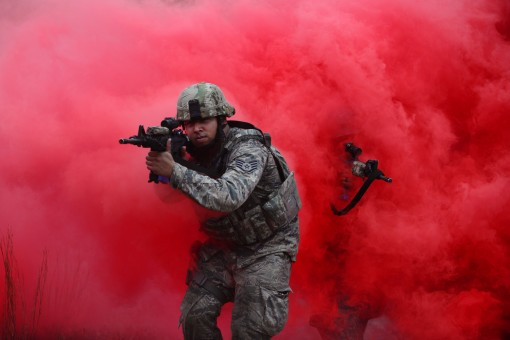 Members of the 106th Rescue Wing Security Forces Squadron manuver through concealing smoke during Tactical Combat Casualty Care training at FS Gabreski Air National Guard Base on Wednesday, October 19 2016.During this training airmen learned to react to e