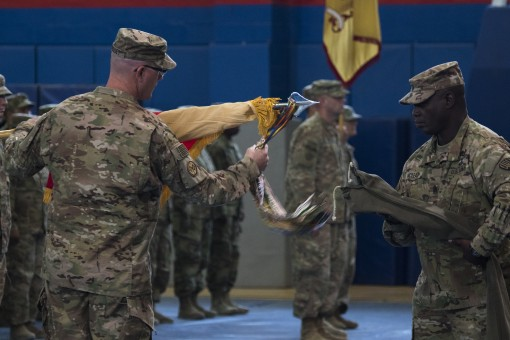 New York Army National Guard Col. Stephen M. Bousquet Commander of the 369th Sustainment Brigade and Command Sgt. Maj. Anthony V. Mclean uncase the brigade colors transferring authority from the 17th Sustainment Brigade to the 369th Sustainment Brigade du