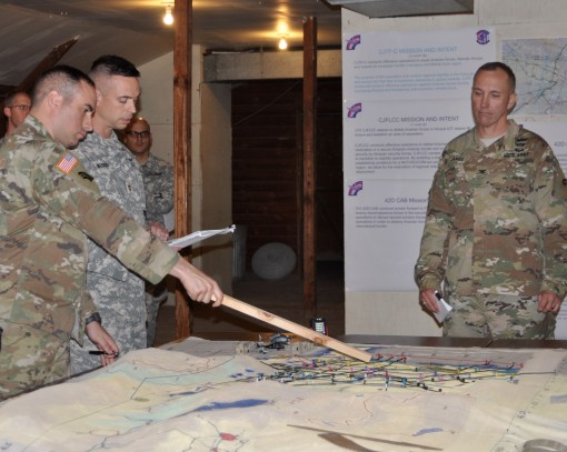 New York Army National Guard Col. Jack James commander of the 42nd Combat Aviation Brigade (right) listens as a leader outlines his units actions during a rehearsal of concept briefing at Fort Indiantown Gap Pennsylvania on Sunday Nov. 6 conducted as part