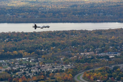 A remotely piloted MQ-9 Reaper operated by the New York Air National Guard's 174th Attack Wing flies a routine training mission over Central New York on October 23 2016. The Civil Air Patrol provides chase plane operations for the MQ-9 to and from re