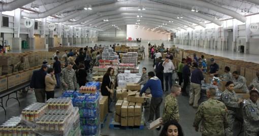 New York Army National Guard Soldiers and Airmen from Joint Task Force Empire Shield and the Citizens Preparedness Corps training team, New York Guard volunteers and civilian volunteers teamed up to pack Thanksgiving boxes with food donated by Walmart. Th