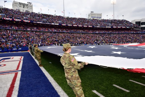 Volunteers from the New York Army and Air National Guard participate in pregame ceremonies