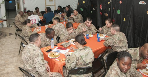 Soldiers of the New York Army National Guard's 369th Sustainment Brigade share a Thanksgiving meal together at the base on Nov. 26, 2011. The brigade headquarters is deployed in Kuwait to coordinate logistics support for U.S. forces in the Central Co