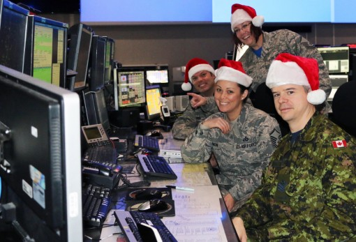 Eastern Air Defense Sector personnel conduct training in preparation for Santa tracking operations. Pictured from front to back, are: Sgt. Thomas Vance of the Royal Canadian Air Force, a member of EADS Canadian Detachment; and Master Sgt. Michelle Gagnon,