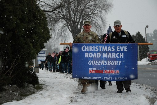 Soldiers from the Queensbury Readiness Center join dozens of military family members and hundreds of friends and community residents for the 13th annual Christmas Eve road march