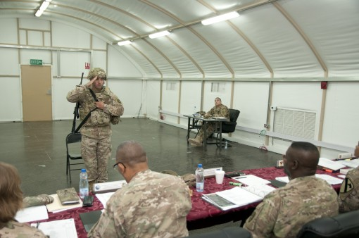 New York Army National Guard Sgt. Damian Acevedo a mem ber of the  369th Sustainment Brigade reports to the 369th Sustainment Brigade NCO of the quarter board at Camp Arifjan Kuwait  January 4 2017. Soldiers from the brigade and its subordinate battalions