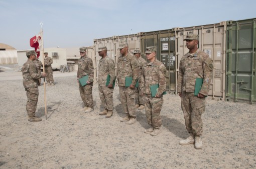 Soldiers assigned to the 369th Sustainment Brigade of the New York Army National Guard in formation after being awarded Army Achievement Medals for their performance at Camp Arifjan, Kuwait Jan. 26, 2017. More than 250 members of the 369th Sustainment Bri