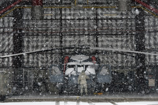Airmen respond to an intense yet brief snowstorm that hit the 106th Rescue Wing of the New York Air National Guard at F.S. Gabreski Air National Guard Base in Westhampton Beach New York January 31 2017.
